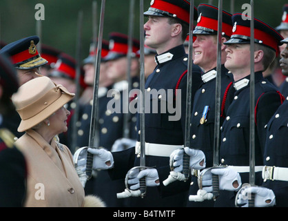 Britain s Prince Harry second from right grins and his grandmother Queen Elizabeth II smiles as she inspects the - Stock Photo
