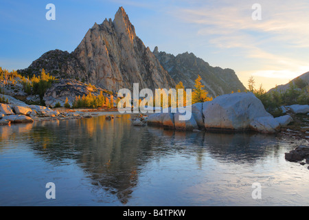 Prusik Peak from an icy Gnome Tarn in the Enchantment Lakes area of the Alpine Lakes Wilderness, Washington - Stock Photo