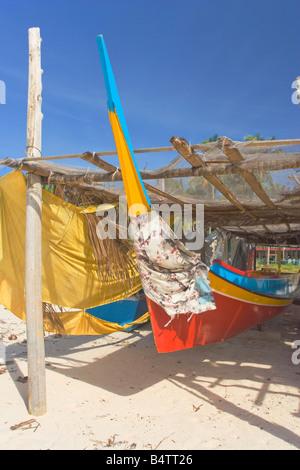 A fishing boat on the beach on Mabul Island nr Semporna Sabah Malaysia - Stock Photo