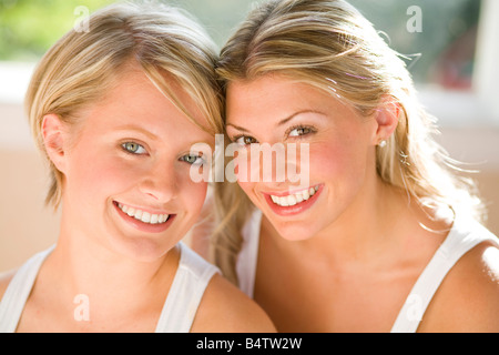 Portrait of two attractive girls - Stock Photo