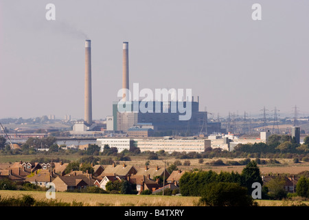Black smoke being emitted from one of a pair of chimneys of the Barking coal fired power station on the banks of - Stock Photo