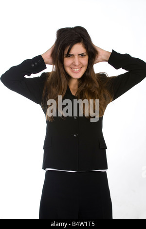 Business woman pulling hair - Stock Photo