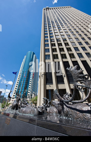 Bronze sculpture of caribous crossing river, outside the Richardson Building with the Canwest Place building
