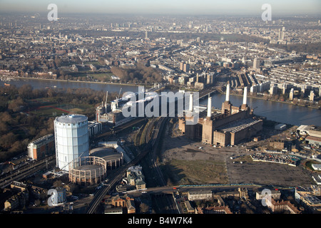 Aerial view north west of Chelsea Bridge Battersea Railway Bridge River Thames gas works Battersea Power Station - Stock Photo