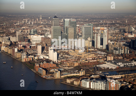 Aerial view north east of Canary Wharf tower blocks Millwall Outer Dock residential buildings River Thames London - Stock Photo
