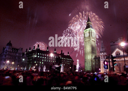 A firework display lights up Big Ben January 2000 as part of the Millennium celebrations in central London January - Stock Photo