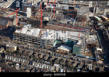 Aerial view north east of Westfield White City Development Construction Site suburban terraced houses Wood Lane - Stock Photo