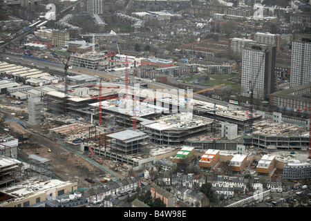 Aerial view north east of Westfield White City Development Construction Site suburban houses tower blocks London - Stock Photo