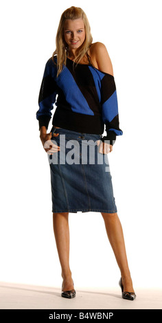 Fashion feature October 2003 knee length skirts model Amy M wearing denim pencil skirt from Warehouse and blue black - Stock Photo