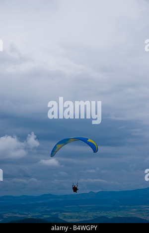 Paragliders on Le Puy de Dome France - Stock Photo
