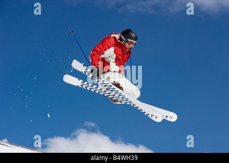 Skier performing jumping trick - Stock Photo