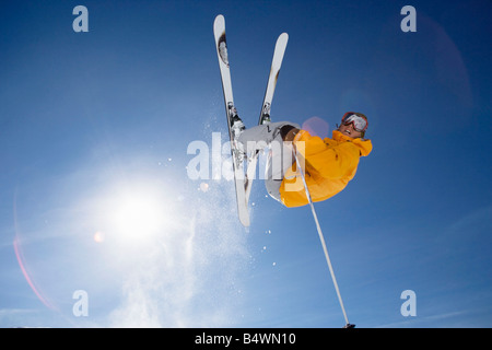 Skier jumping shot from bellow - Stock Photo