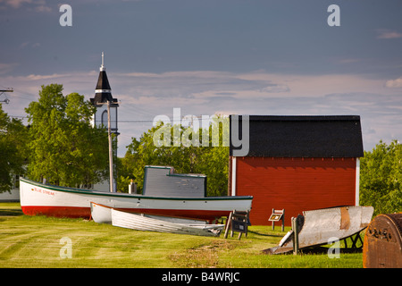 Old Boats and red shed in Hecla Village on the shores of Lake Winnipeg, Hecla Island, Manitoba, Canada - Stock Photo