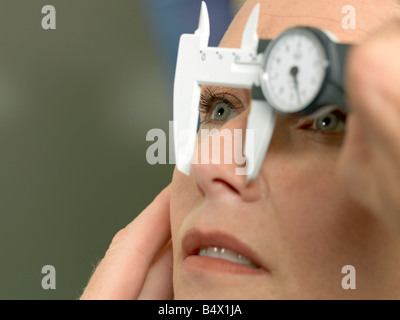 Doctor preparing patient for surgery - Stock Photo