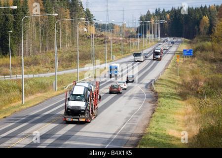 Russian trucks driving on Finnish highway - Stock Photo