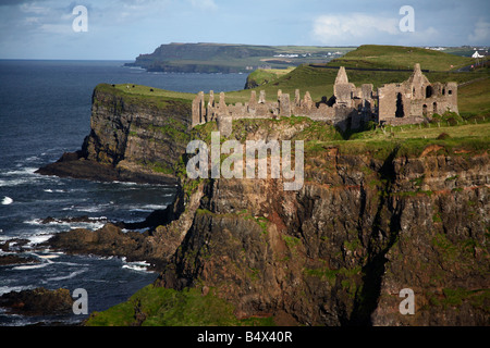 dunluce castle and the north antrim coastline county antrim northern ireland uk legend has it that one night in - Stock Photo