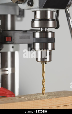 Drill press and wood - Stock Photo