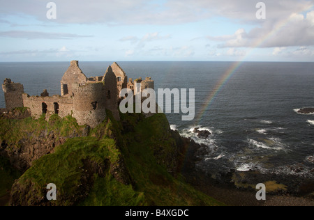 dunluce castle with rainbow and the north antrim coastline county antrim northern ireland uk