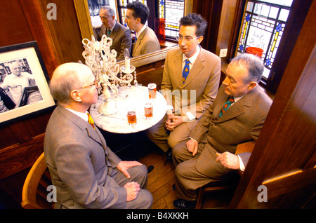 Gilbert & George meet Daily Mirror features writer Damien Fletcher. Local pub drinks.