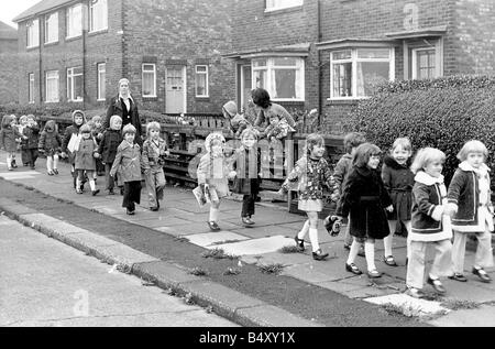 A mystery hole in the playground of Hebburn Quay Infants School meant that these children had to be evacuated As - Stock Photo