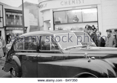The Beatles Pop Group November 1963 Paul McCartney seen through the car window as The Beatles arrive at the Odeon - Stock Photo