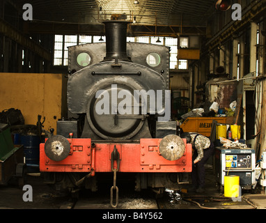 An engineer preparing the Barclay 0 4 0pt saddle tank locomotive Annie at Chatham Historic Dockyard in Kent - Stock Photo