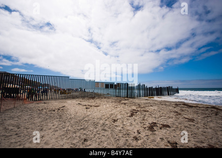 A view of the International Border between the United States and Mexico, from the US side of the beach. - Stock Photo