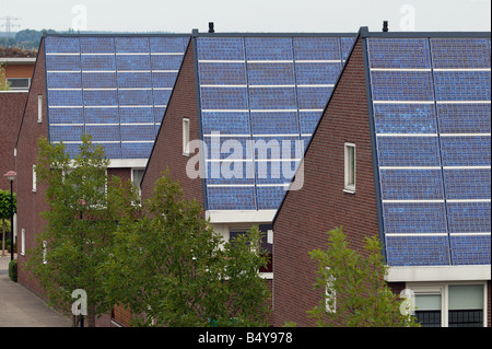 Shell solar panels fitted to houses on the world's largest solar powered housing estate, Nieuwland, Amersfoort, - Stock Photo