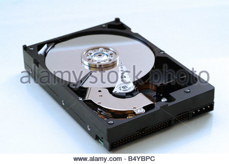 Computer hard drive opened up - Stock Photo