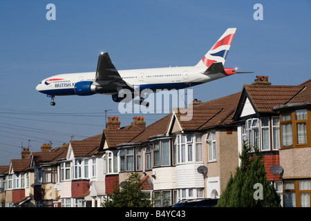 British Airways Boeing 777 plane landing at London airport. (41) - Stock Photo