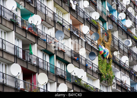 Many satellite dishes fixed to balconies of apartment building built as social housing at Pallasstrasse in Schoneberg - Stock Photo