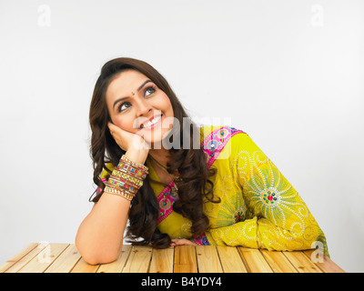 indian woman origin in her traditional dress posing in front of the camers - Stock Photo
