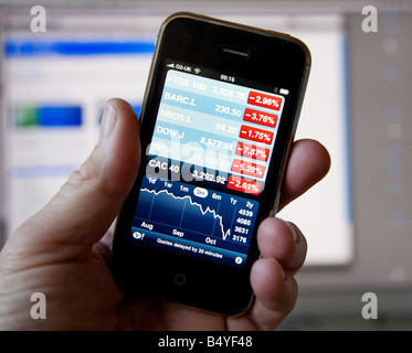 Stock markets shown in the red on an iPhone screen - Stock Photo