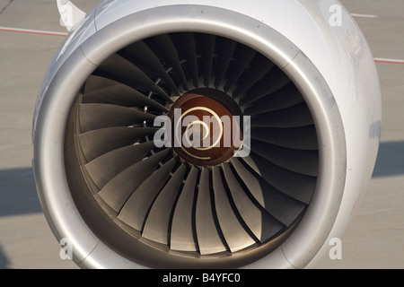 Close up view of the fan blades in an airplane jet engine air intake. No proprietary details visible. - Stock Photo