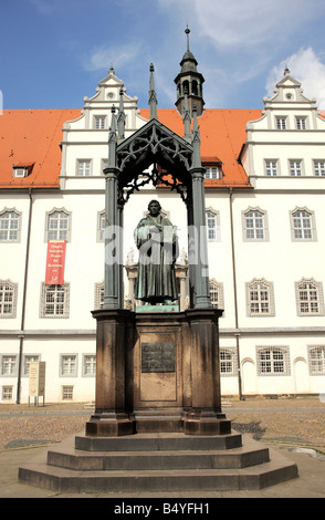 Martin Luther statue on the market place in Wittenberg, Germany. - Stock Photo