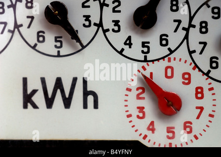 Domestic electricity meter at a property in Bawdsey, Suffolk, UK. - Stock Photo