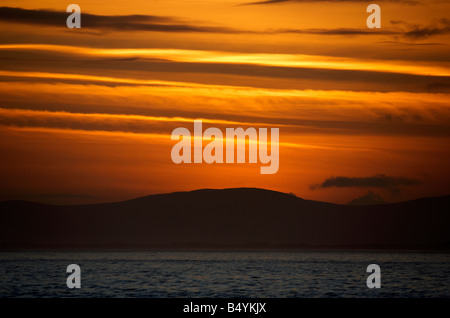 sunset over the fanad peninsula of county donegal republic of ireland as seen from portstewart county londonderry - Stock Photo