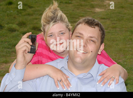 Dave Brown and wife Michelle Kitson They met after Dave saw a mystery mobile phone number in his sleep woke up and - Stock Photo