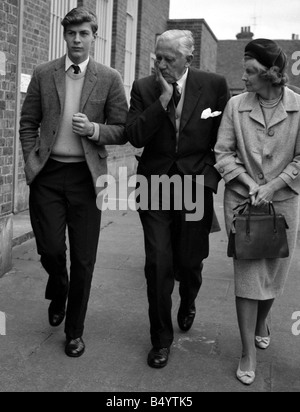 Ranulph Twisleton Wickham Fiennes seen here with his godfather Sir Ernest Gowers and his mother Lady Fiennes leaving - Stock Photo