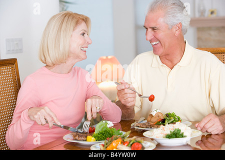 Elderly Couple Enjoying Healthy Meal Together - Stock Photo