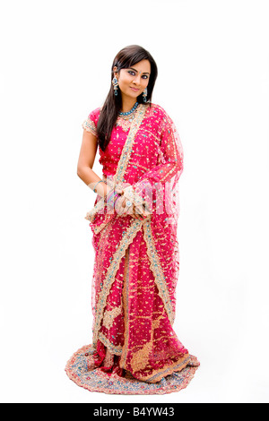 Beautiful Bangali bride in colorful dress standing isolated - Stock Photo