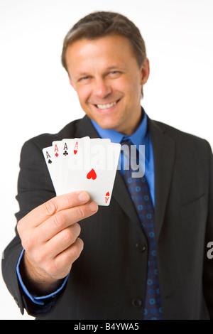 Businessman Holding Four Aces - Stock Photo