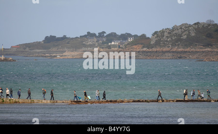 At Point de l Arcouest people walk to the ferry to Ile de Brehat. - Stock Photo