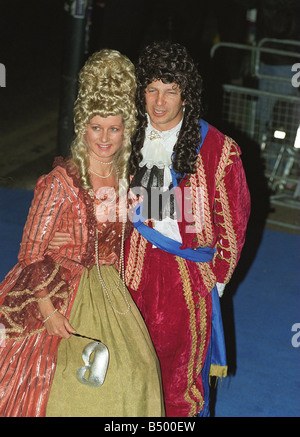 David Gower former England Cricketer with his wife Thorunn dressed in period costume from Charles 1st era arriving - Stock Photo
