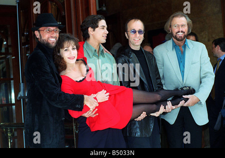 Bee Gees POP Group October 97 At the launch of the stage version of the hit film Saturday Night Fever Posing outside - Stock Photo