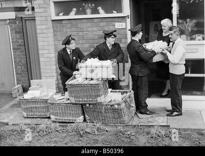 Beatles files 1964 Postmen deliver bags of cards for George Harrison parents home 1964 - Stock Photo