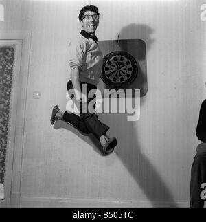 Freddie Garrity of Freddie and The Dreamers pictured in 1965 leaping in the air - Stock Photo