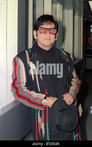 Roy Orbison at Heathrow Airport November 1988 in multi coloured coat - Stock Photo