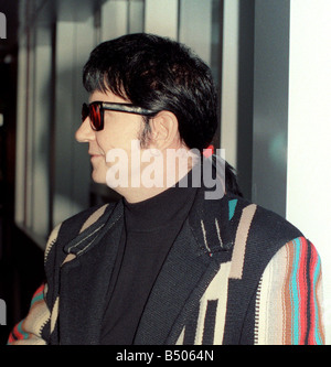 Roy Orbison at Heathrow Airport November 1988 in multi coloured coat and with ponytail - Stock Photo