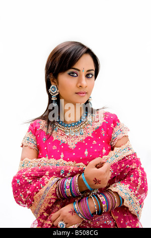 Beautiful Bangali bride in colorful dress isolated - Stock Photo